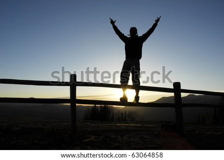 Man celebrating on top of mountain in Telluride Colorado. - stock photo