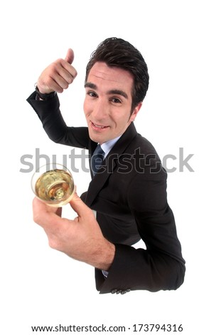 Man celebrating with champagne - stock photo