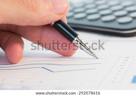 Man checking figures on a financial report