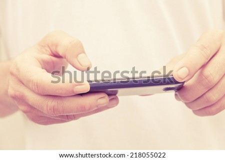 man checking his phone - stock photo