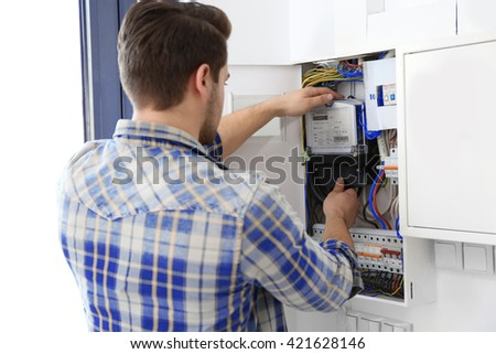 Man checking switch box closeup
