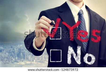 Man Checking the Yes Box above the city - stock photo