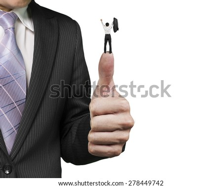 Man cheering on top of another big thumb against white background - stock photo