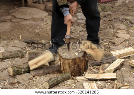 stock-photo-man-chopping-fire-wood-with-