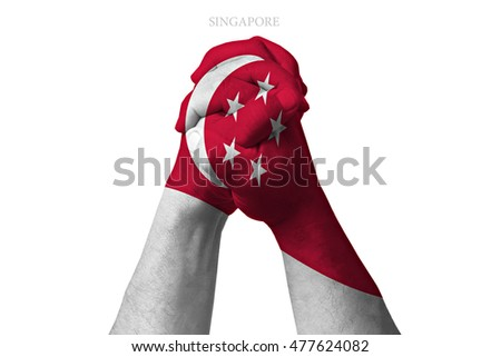 Man clasped hands patterned with the SINGAPORE flag