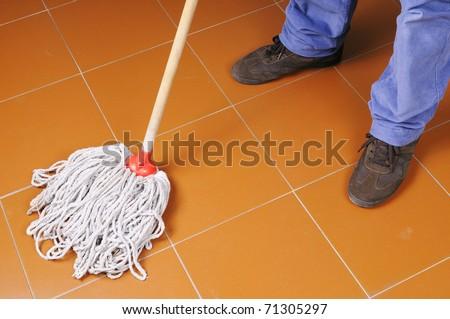 Man cleaning floor - stock photo
