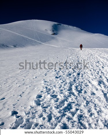 Man climbing at Breithorn - stock photo