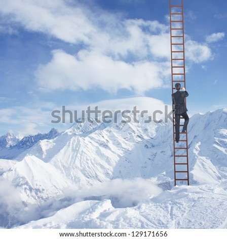 man climbing on ladder and mountains - stock photo