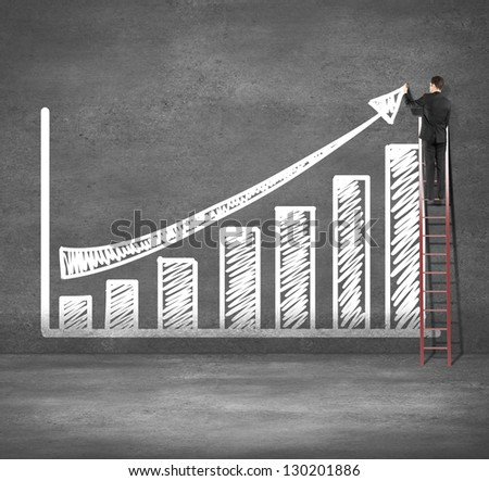 man climbing on ladder drawing business chart - stock photo