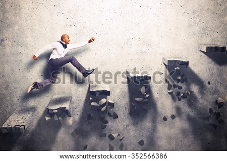 Man climbs the steps of collapsing ladder - stock photo