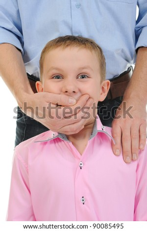 man closes a mouth a hand to the boy. Isolated on white background
