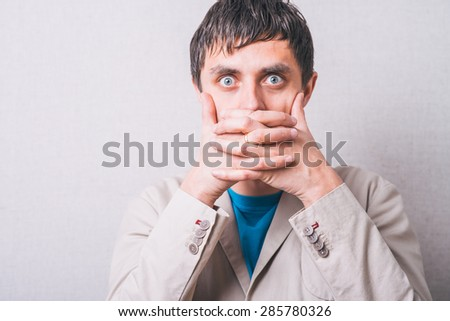 man closes her mouth - stock photo