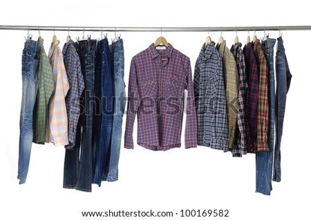 man clothes and trousers of different colors on hangers - stock photo