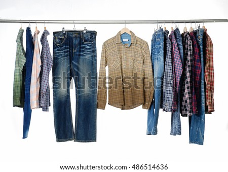 man clothes, jeans with trousers on hangers