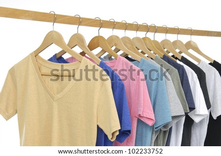 man clothes of different colors shirt on wooden hangers