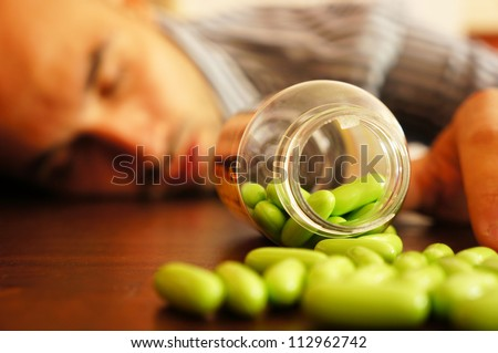 Man collapsed after a overdose of drugs - stock photo