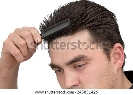 man combing his hair - stock photo
