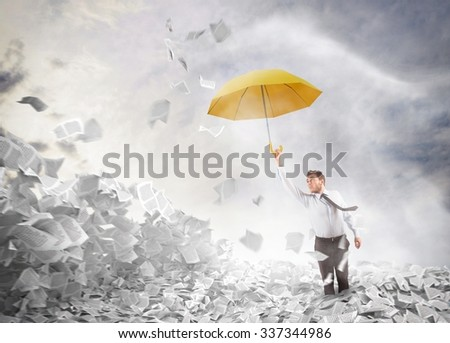 Man comes out of a sheets pile - stock photo