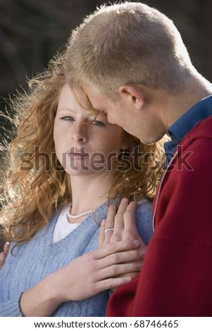 Man Comforting A Woman - stock photo