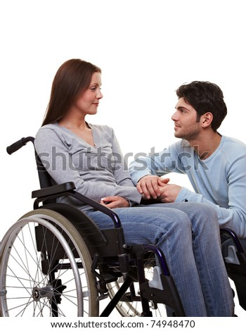 Man comforting a young woman in a wheelchair - stock photo