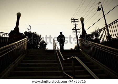 Man commuting on stairs - stock photo