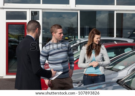 Man concluding a contract in a dealership - stock photo