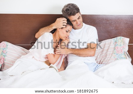 Man consoles his wife lying bed in bedroom  couple consoling  husband  embrace comforts his. Man Consoles His Wife Lying Bed Stock Photo 181892675   Shutterstock