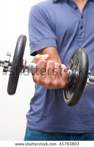 Man contracting biceps while doing some exercises - stock photo