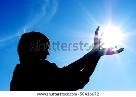 Man control the sun. Conceptual design. - stock photo