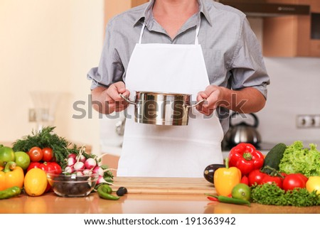 Man cooking. Male chef cooking in the kitchen - stock photo