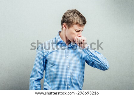 man coughs - stock photo