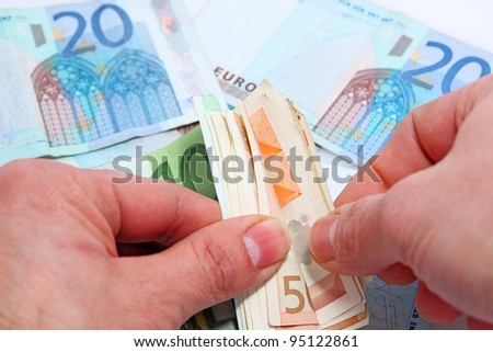 man counting money - stock photo