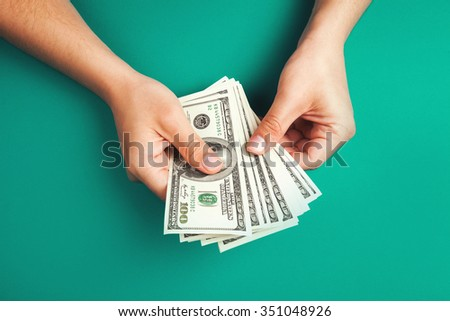 Man counting money, corruption concept, allocation of money - stock photo