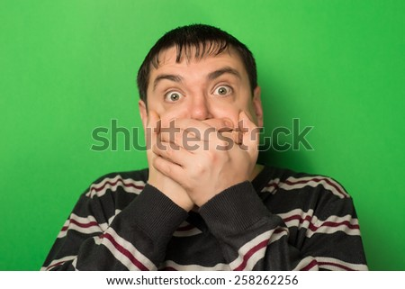 man covered his face with his hands, fear - stock photo