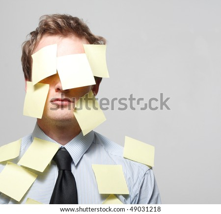 Man covered in yellow notes - stock photo