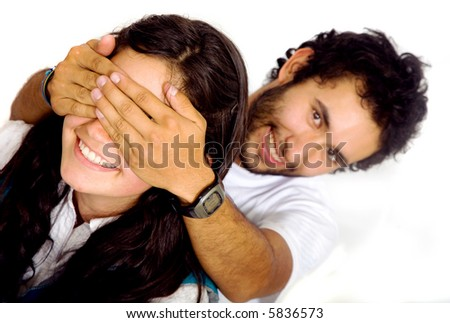 man covering a girls eyes to see if she can guess who is behind her - isolated over a white background - stock photo