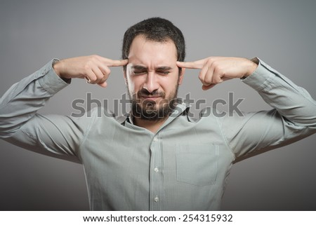Man covering his hears - stock photo