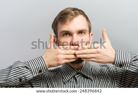 Man covering his mouth - stock photo
