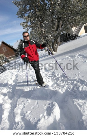Man cross-country skiing - stock photo