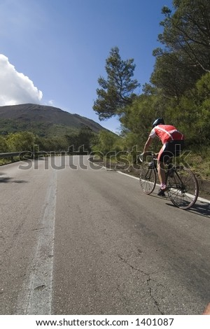 Man cycling and climbing to the victory on the road to Vesuvius volcano peak,Naples, Italy