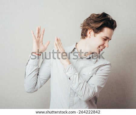 man dances and claps his hands - stock photo