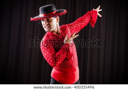 Man dancing spanish dance in red clothing - stock photo