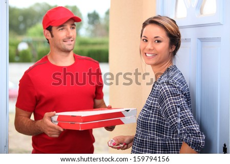 Man delivering pizza - stock photo