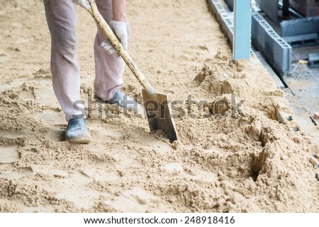man digging in the ground with shovel and spade. - stock photo