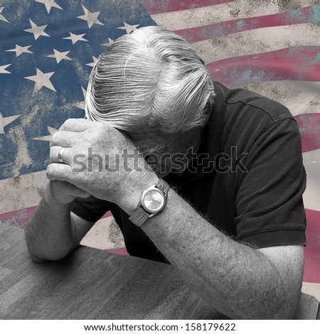 Man distressed and praying for his country - stock photo