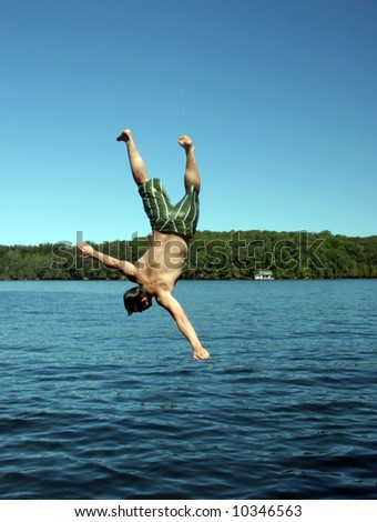 Man diving - stock photo