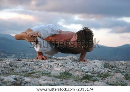 Man doing a ashtavakrasana. Hand standing.
