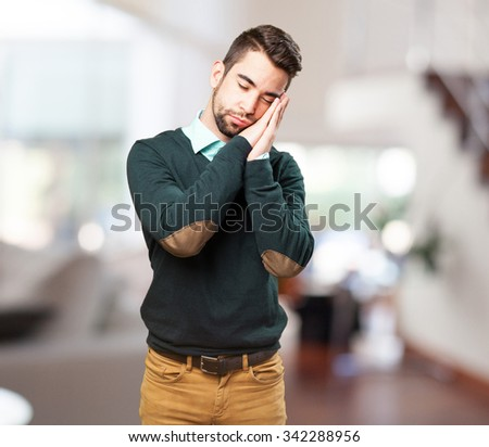 man doing a sleep gesture