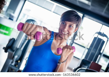Man doing crunch abs on fitball - Stock Image - stock photo