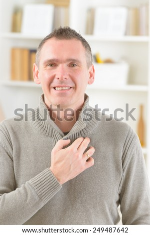 Man doing EFT on the under collarbone. Emotional Freedom Techniques, tapping, a form of counseling intervention that draws on various theories of alternative medicine.  - stock photo